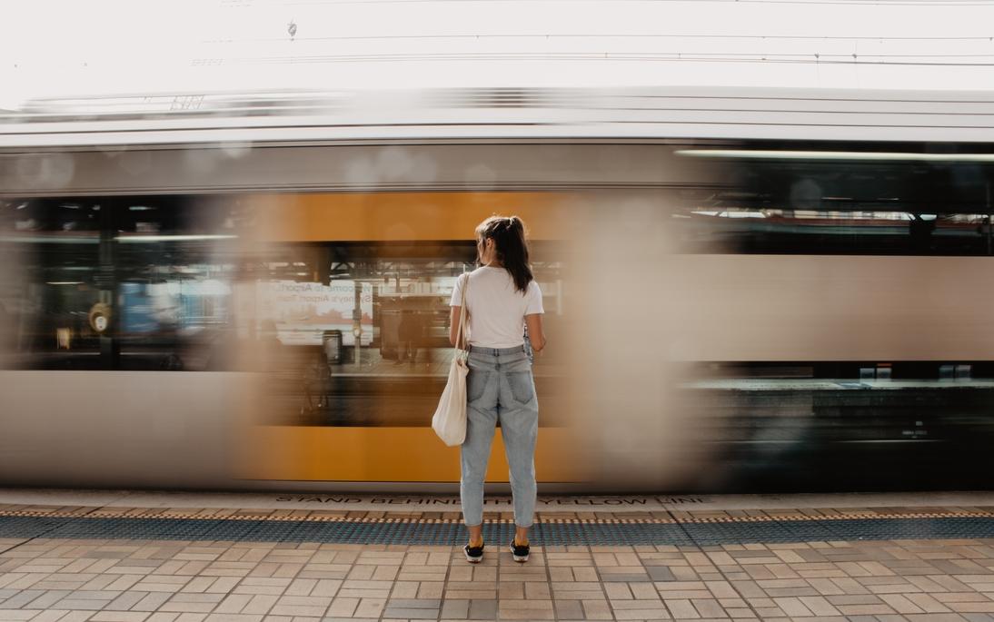 Woman at train platform.